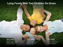 Lying Family With Two Children On Grass