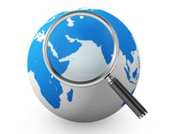 Magnifier With Globe Stock Photo