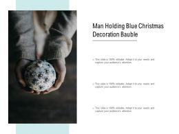 Man Holding Blue Christmas Decoration Bauble
