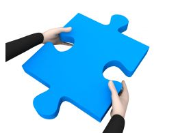 Man Holding Blue Puzzle In Hand Stock Photo