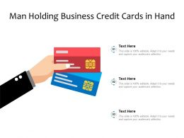 Man Holding Business Credit Cards In Hand