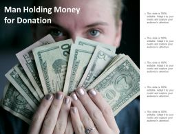 Man Holding Money For Donation