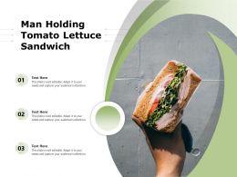 Man Holding Tomato Lettuce Sandwich