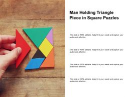 Man Holding Triangle Piece In Square Puzzles