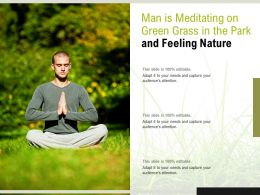Man Is Meditating On Green Grass In The Park And Feeling Nature