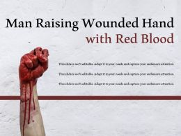 Man Raising Wounded Hand With Red Blood