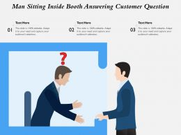 Man Sitting Inside Booth Answering Customer Question
