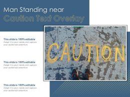 Man Standing Near Caution Text Overlay