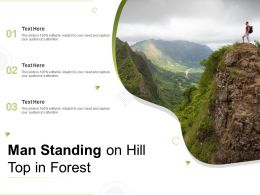 Man Standing On Hill Top In Forest