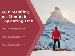 Man Standing On Mountain Top During Trek