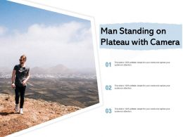 Man Standing On Plateau With Camera
