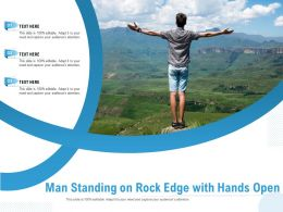 Man Standing On Rock Edge With Hands Open