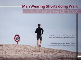 Man Wearing Shorts Doing Walk Run Near Speed Limit Post