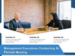 Management Executives Conducting In Person Meeting