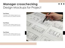 Manager Crosschecking Design Mockups For Project