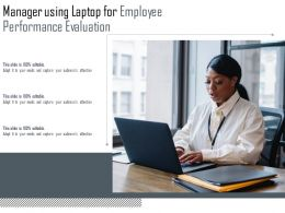 Manager Using Laptop For Employee Performance Evaluation