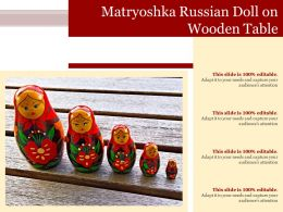 Matryoshka Russian Doll On Wooden Table