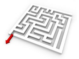 Maze With Red Arrow Way Out Displaying Solution Stock Photo