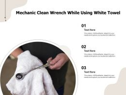 Mechanic Clean Wrench While Using White Towel