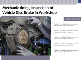 Mechanic Doing Inspection Of Vehicle Disc Brake In Workshop