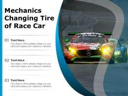 Mechanics Changing Tire Of Race Car
