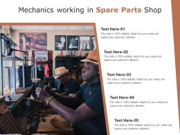 Mechanics Working In Spare Parts Shop