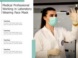 Medical Professional Working In Laboratory Wearing Face Mask