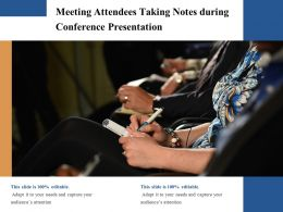 Meeting Attendees Taking Notes During Conference Presentation
