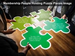 Membership People Holding Puzzle Pieces Image