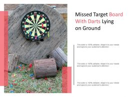 Missed Target Board With Darts Lying On Ground
