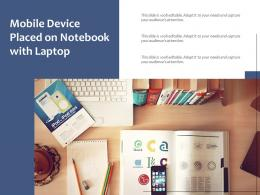 Mobile Device Placed On Notebook With Laptop