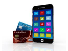 Mobile Loaded With Apps And Two Credit Cards On Side Stock Photo