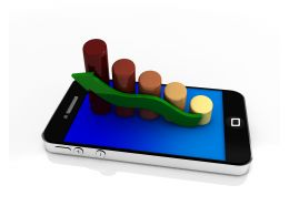 Mobile Phone With Bar Graph And Green Arrow For Growth Stock Photo