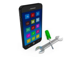 Mobile Phone With Wrench And Screwdriver Showing Tools And Service Stock Photo