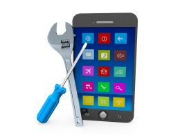 Mobile Phone With Wrench And Screwdriver Stock Photo