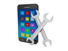 Mobile With Two Wrenches For Tools And Service Stock Photo