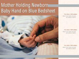 Mother Holding Newborn Baby Hand On White Bedsheet