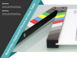 Multicolor Clapboard Placed On Glass Table