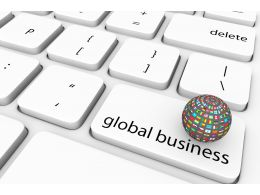 Multicolor Globe On White Keyboard With Global Business Key Stock Photo