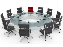 Multiple Chairs In Circle With One Red Chair Stock Photo