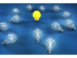 Multiple Glass Bulbs With One Yellow Bulb For Leadership Stock Photo