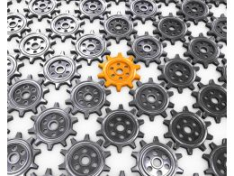 Multiple Grey Gears With One Yellow Gear As Leader Stock Photo
