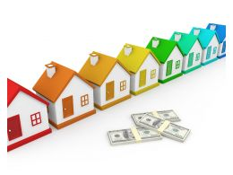 Multiple Houses As Housing Group With Dollars Stock Photo