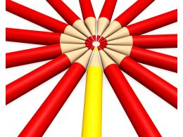 Multiple Red Colored Pencils With One Yellow As Leader Stock Photo