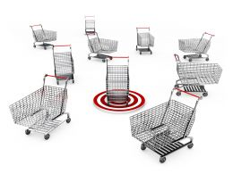 Multiple Shopping Carts With Dart To Show Target Of Shopping Stock Photo