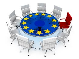 Multiple Silver Chairs With Red Chair As Leader And European Symbol Stock Photo