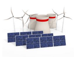 Multiple Solar Panels With Windmill Stock Photo
