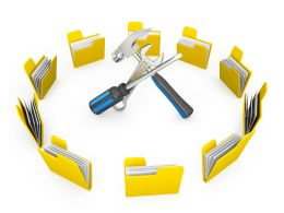 Multiple Yellow Folders In Circle With Hammer Screwdriver In Center Stock Photo