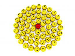 Multiple Yellow Sad Emoticons With Happy Red One In Center Stock Photo