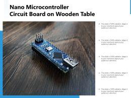 Nano Microcontroller Circuit Board On Wooden Table